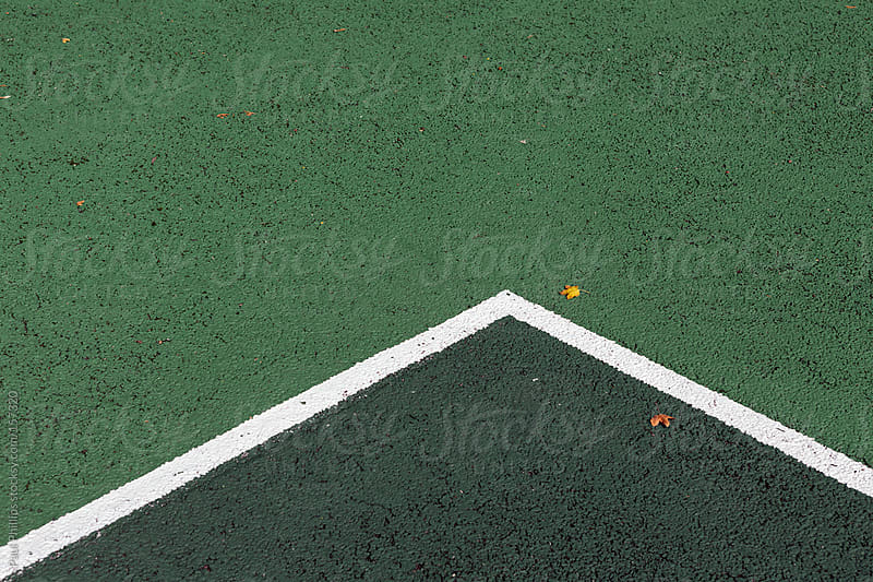 Lines at the corner of a green tennis court by Paul Phillips for Stocksy United