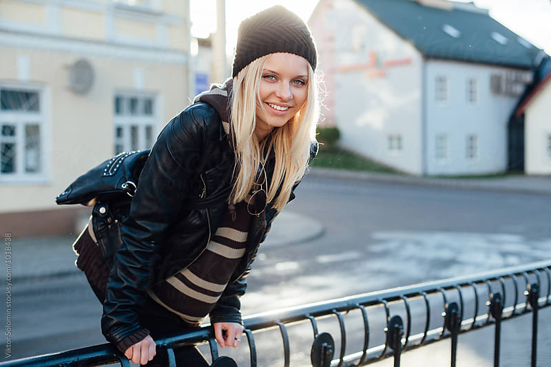 Pretty blonde woman posing on the street by Viktor Solomin for Stocksy United