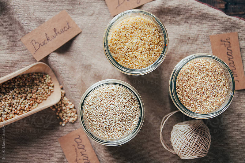 Quinoa, amaranth, bulgur and buckwheat in jars by Nataša Mandić for Stocksy United