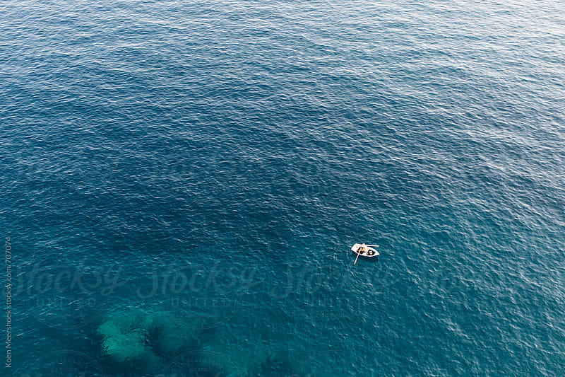 Aerial view of a small fisher boat on the sea by Koen Meershoek for Stocksy United