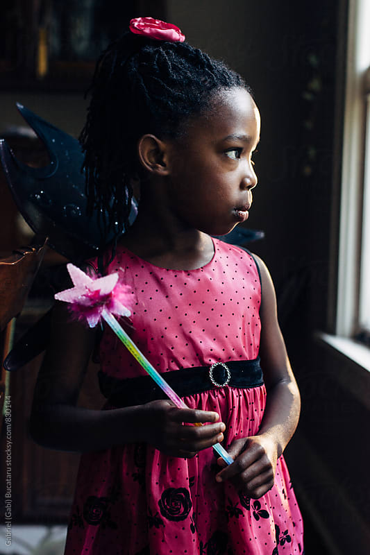 Black girl in pink fairy dress holding a wand by Gabriel (Gabi) Bucataru for Stocksy United