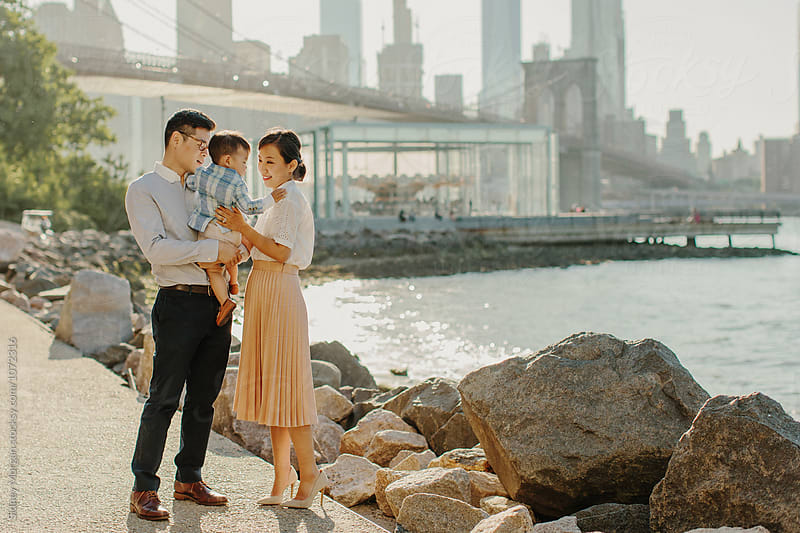 Young Stylish Family in front of Brooklyn Skyline by Sidney Morgan for Stocksy United