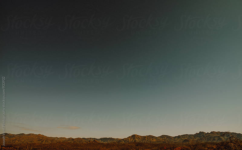 Desert peaks in the distance by Joseph West Photography for Stocksy United