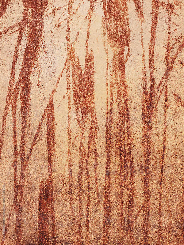 Detail of dripping patterns on rusty metal wall by Paul Edmondson for Stocksy United
