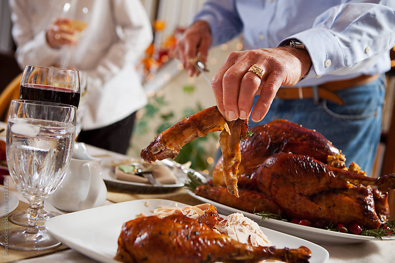 Thanksgiving: Putting The Wing On The Plate by Sean Locke for Stocksy United