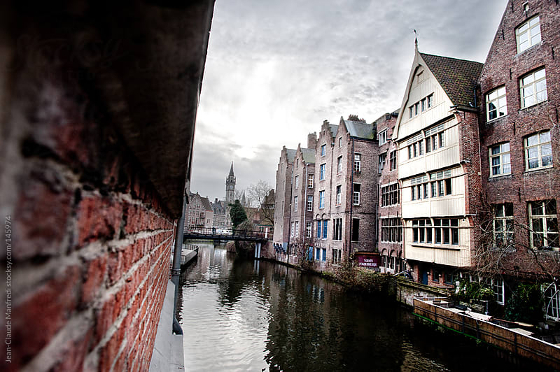 Canal in Bruges (Belgium), with typical houses with Flemish Gothic architecture  by Jean-Claude Manfredi for Stocksy United