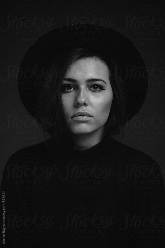Woman in Wide Brim Hat by Adrian Ragasa for Stocksy United