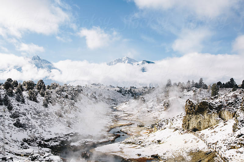 Steaming River Coming Down From Snowy Mountain Landscape by Laura Austin for Stocksy United