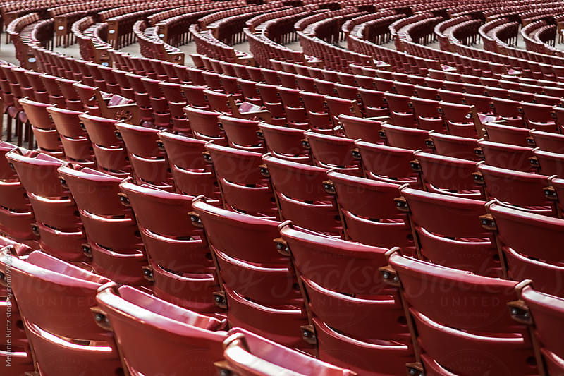 Rows of seats in a stadium by Melanie Kintz for Stocksy United