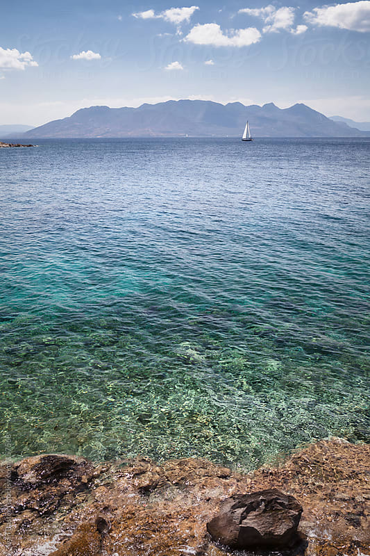 Sailing ship on Aegean Sea seen from Aegina Island in Greece by Ivan Bastien for Stocksy United
