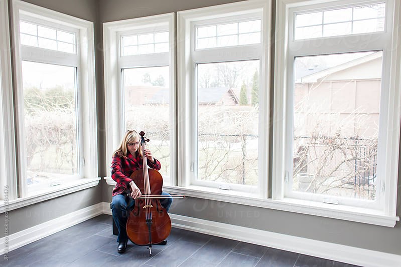 Hipster Woman Practicing the Cello at Home In Bright Sunny Room by JP Danko for Stocksy United