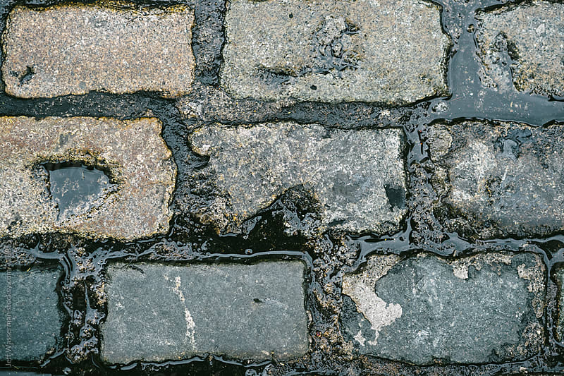 Wet Cobblestone Street Closeup by Jeff Wasserman for Stocksy United