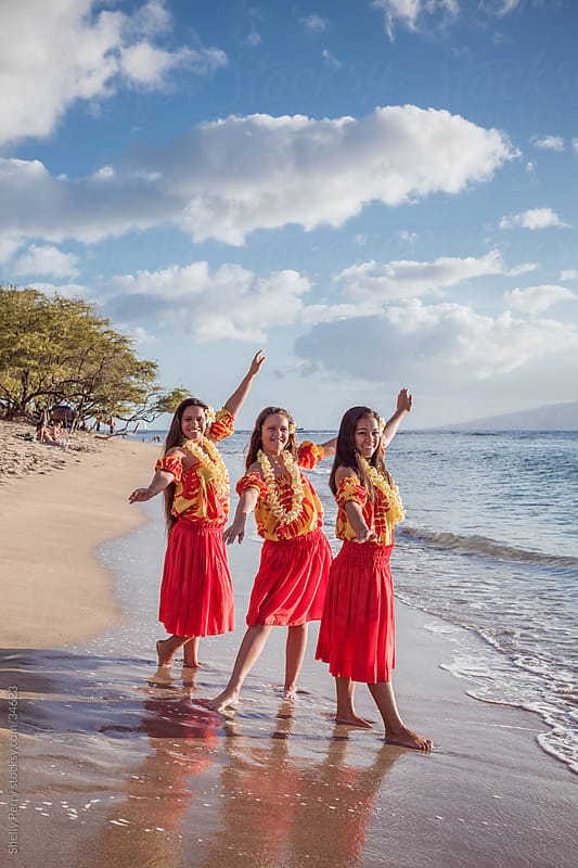 Three Teen Traditional Hawaiian Hula Dancers on the Beach by Shelly Perry for Stocksy United