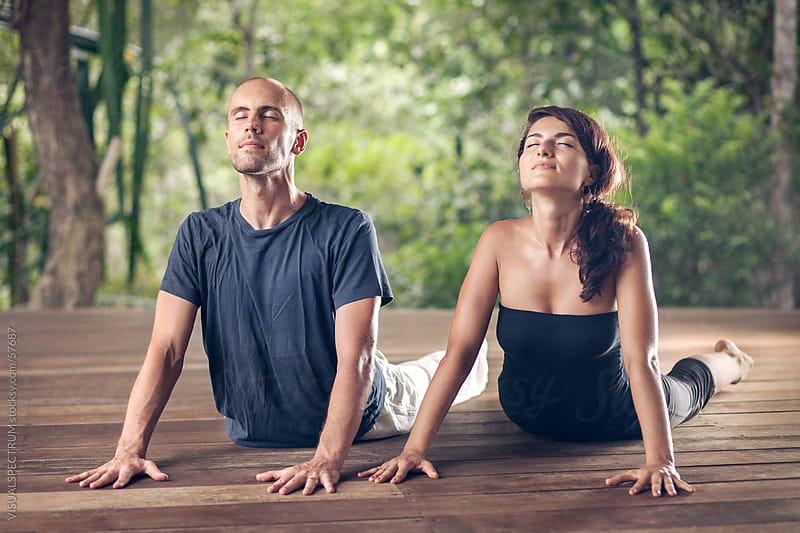 Yoga: A Couple Doing Cobra Pose Together by Julien L. Balmer for Stocksy United