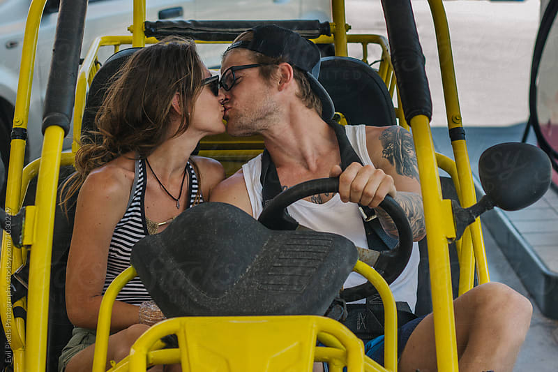 Portrait of a young beautiful couple in buggy car by Evil Pixels Photography for Stocksy United