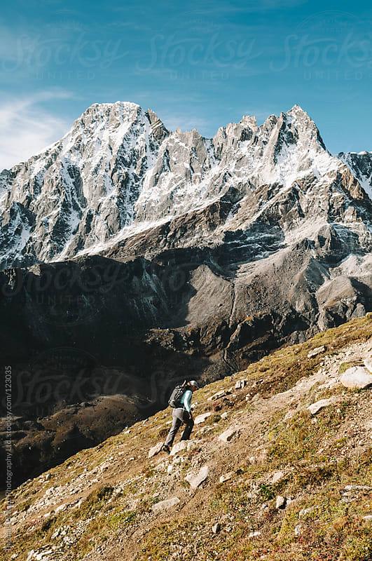 Female trekker climbing Gokyo Peak, Everest Region, Sagarmatha National Park, Nepal. by Thomas Pickard for Stocksy United