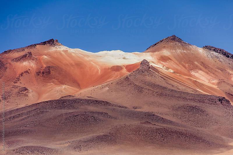 Red coloured mountain in Los Andes, Bolivia desert by Alejandro Moreno de Carlos for Stocksy United