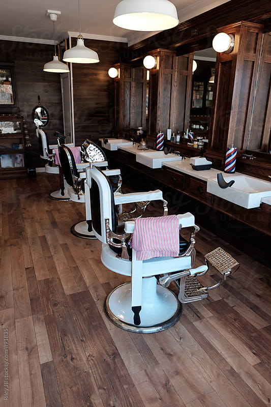 Interior of a vintage styled barber shop. by Riley Joseph for Stocksy United