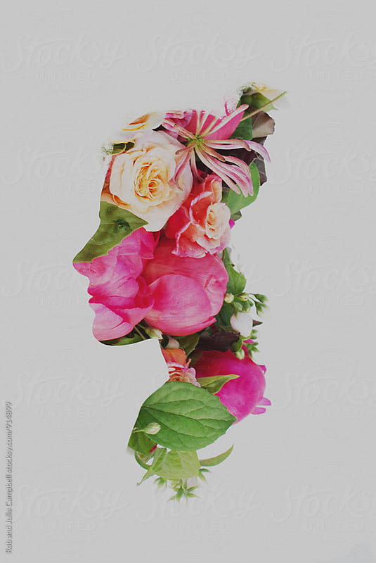 Double exposure of young woman with flowers - profile by Rob and Julia Campbell for Stocksy United
