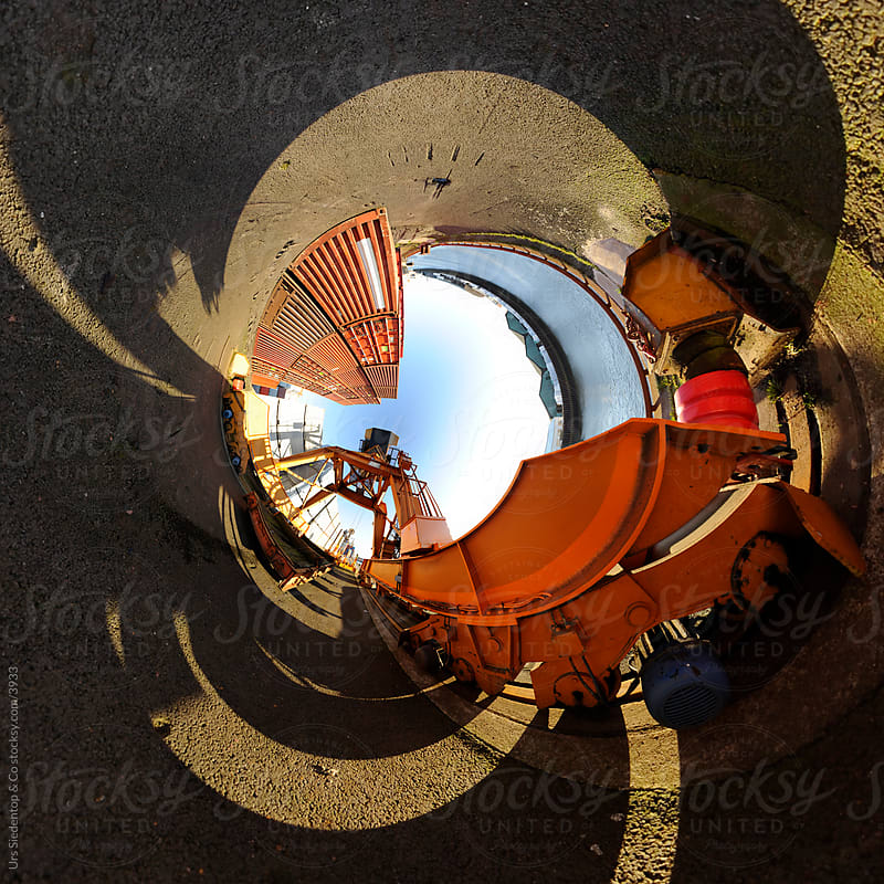 Orange Crane - Little planet spherical panorama inside out by Urs Siedentop & Co for Stocksy United