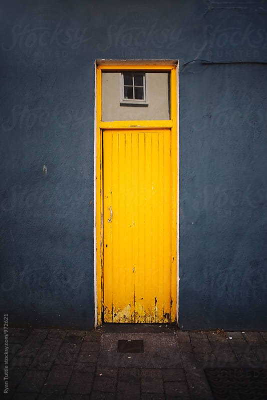 Yellow Door by Ryan Tuttle for Stocksy United