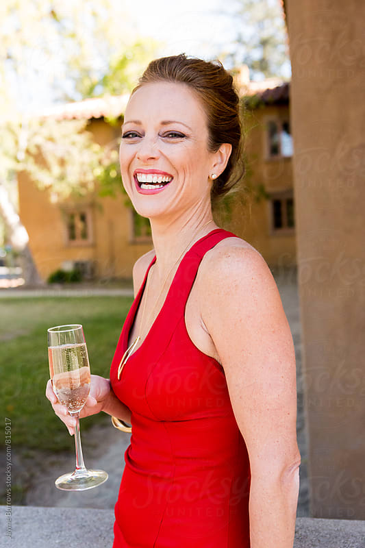Woman with Champagne by Jayme Burrows for Stocksy United