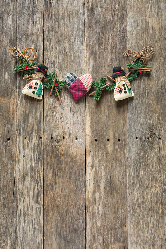 Christmas decoration on a rustic barnwood background by David Smart for Stocksy United