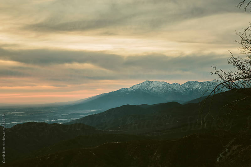 Beautiful sunset of mountain peak covered in snow by Curtis Kim for Stocksy United