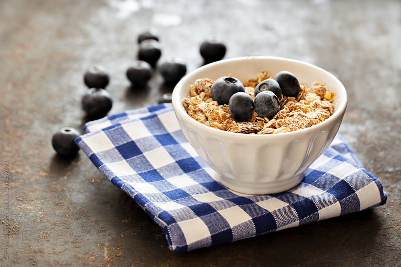 Oats with blueberries  by Corinna Gissemann for Stocksy United