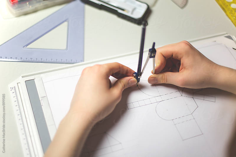 Hands using a compass for technical drawing... by Catherine MacBride for Stocksy United