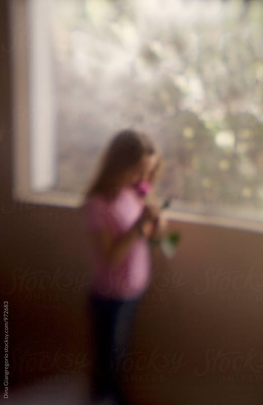 Soft Artistic Image Of Girl Holding Rose By Window by Dina Giangregorio for Stocksy United