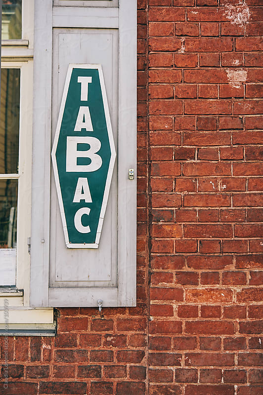 Tobacco Sign by Claudia Lommel for Stocksy United