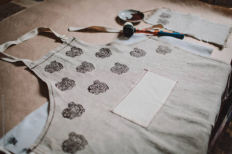 Workplace for the production of handmade aprons  by Sergey Filimonov for Stocksy United