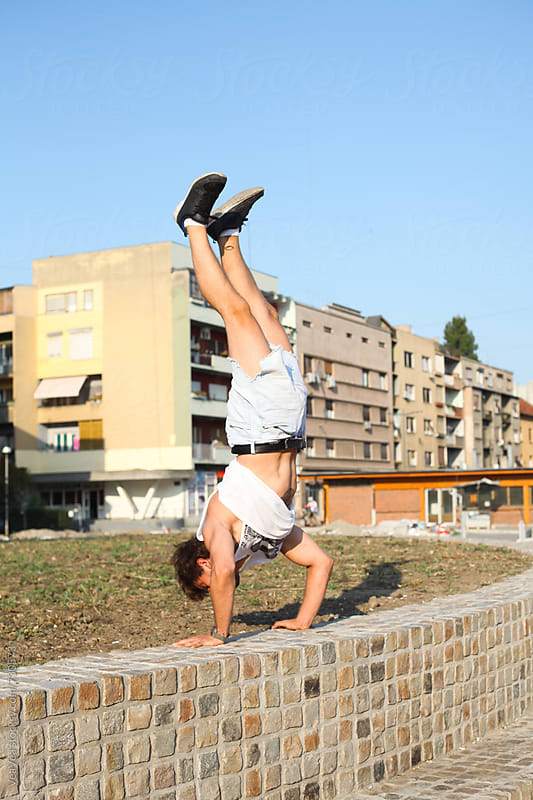 Man doing handstand in the city by Marija Mandic for Stocksy United