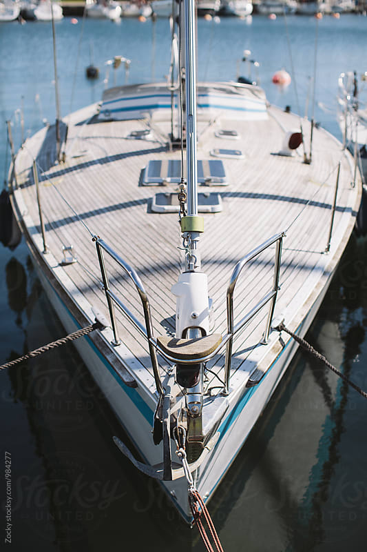Frontside of a sailing yacht in a marina by Zocky for Stocksy United