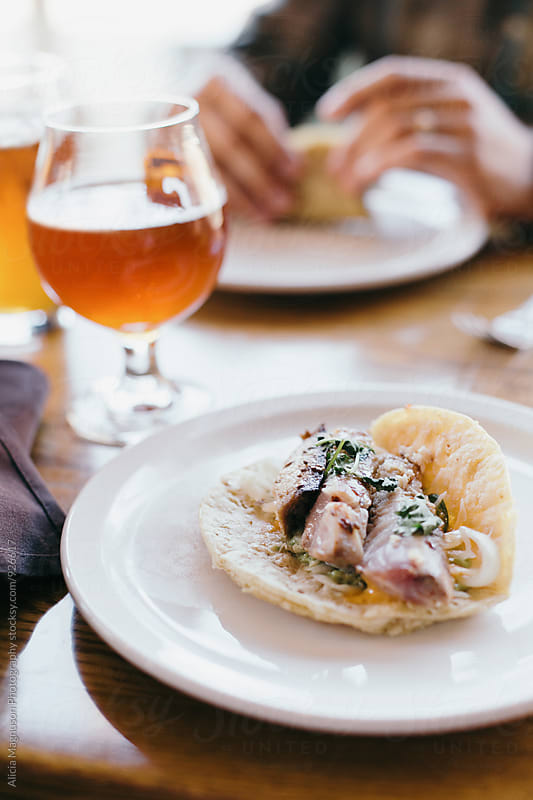 Beer and Fish Tacos by Alicia Magnuson Photography for Stocksy United