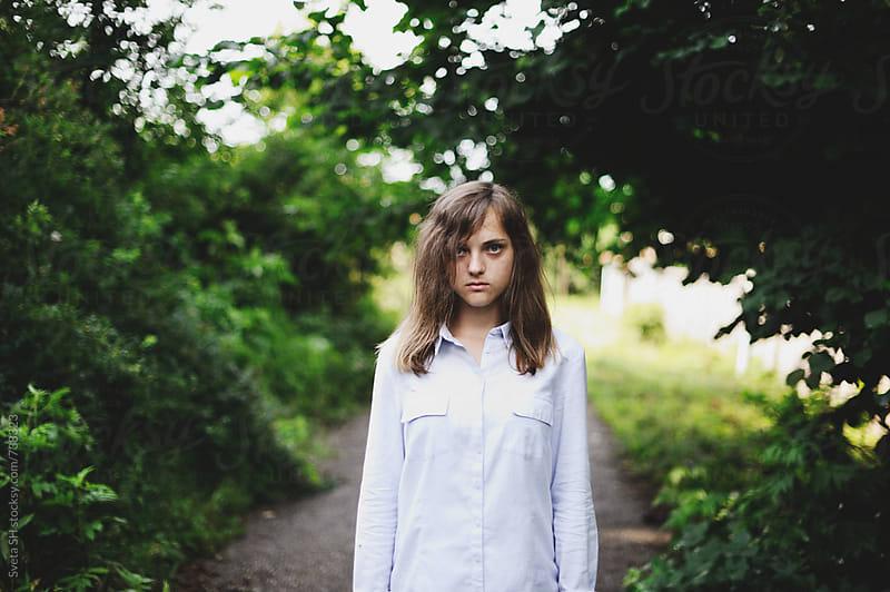 Portrait of a girl in a shirt by Svetlana Shchemeleva for Stocksy United