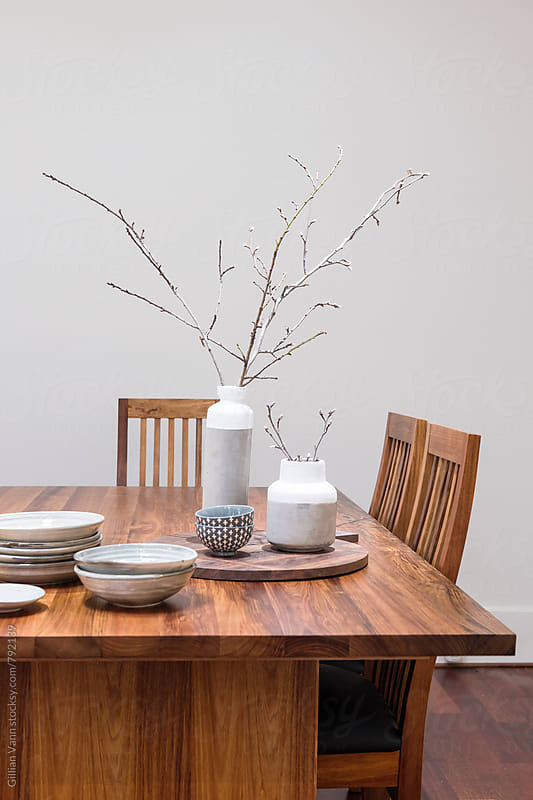 timber dining table with pottery by Gillian Vann for Stocksy United