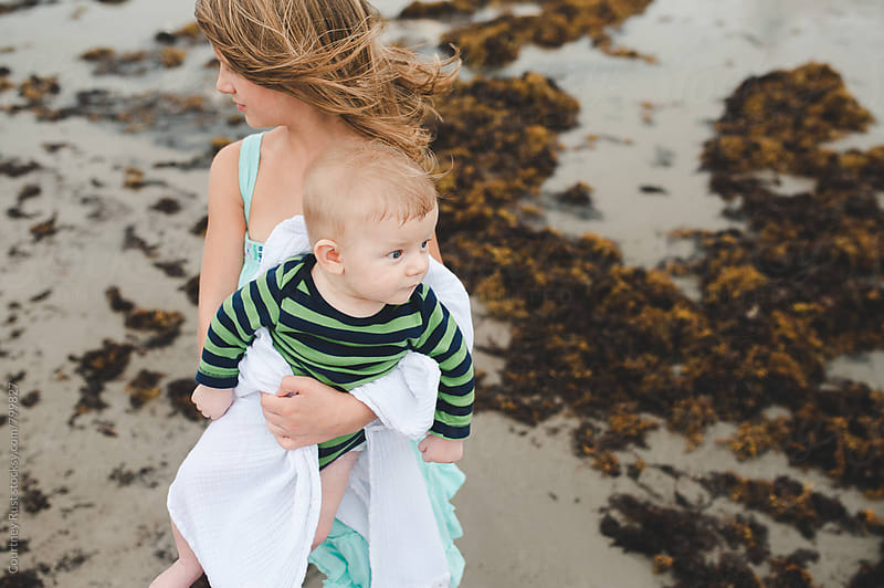Sibling love at the beach by Courtney Rust for Stocksy United