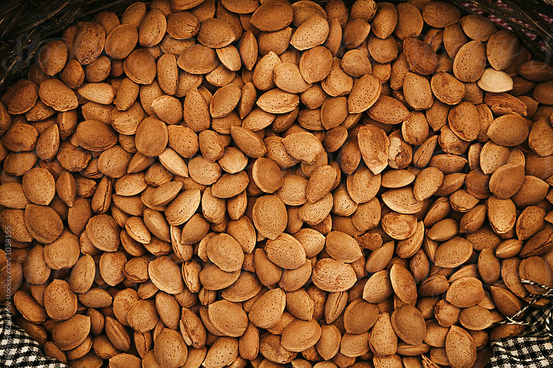 Raw almonds by Borislav Zhuykov for Stocksy United