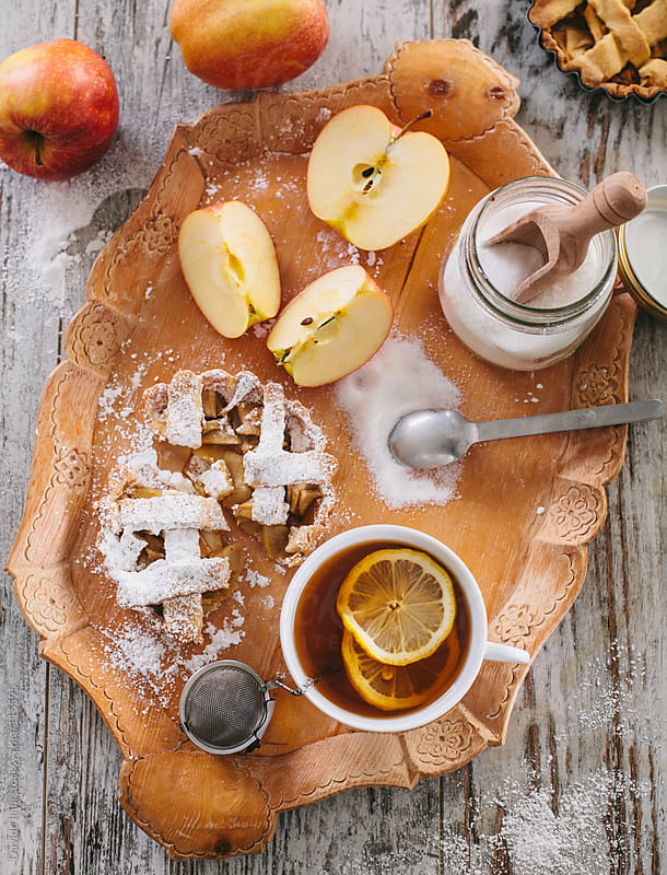 Tea with lemon and apple tart by Davide Illini for Stocksy United