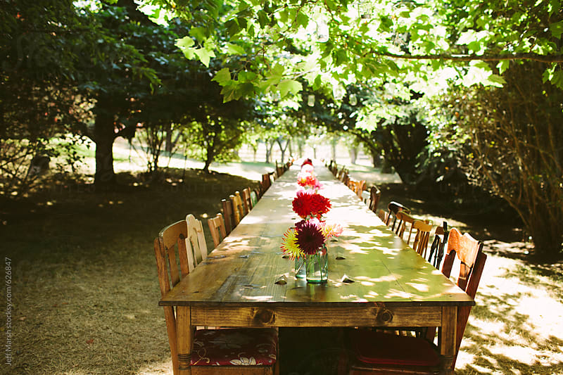 Large dinner table outside by Jeff Marsh for Stocksy United