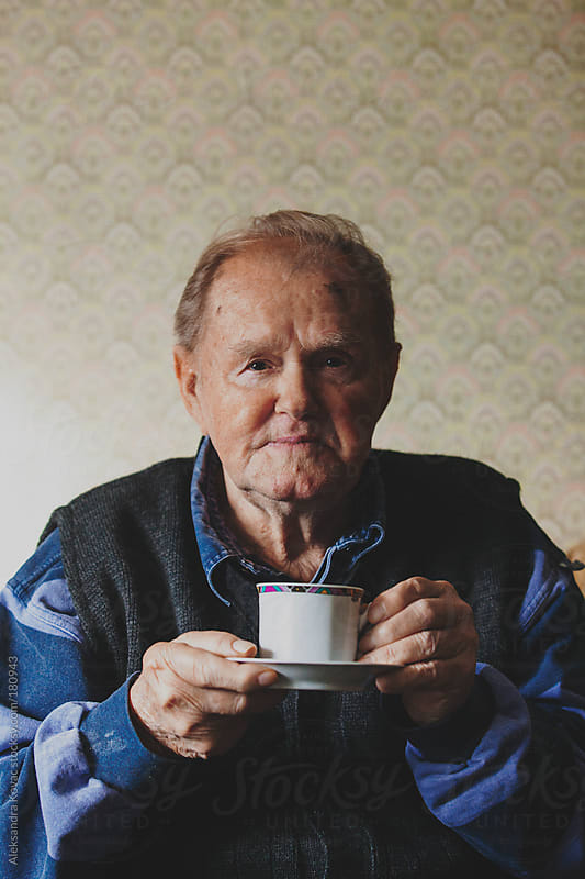 Senior man drinking coffee portrait  by Aleksandra Kovac for Stocksy United
