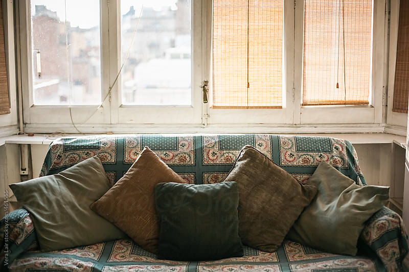 Old sofa, with cushions by Vera Lair for Stocksy United