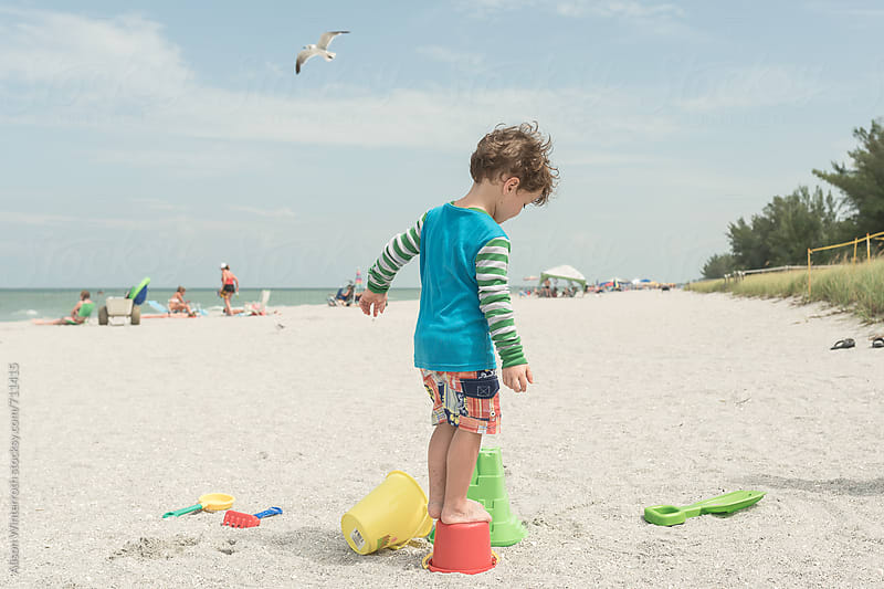 A Little Boy  Plays On The Beach With Buckets and Shovels by Alison Winterroth for Stocksy United