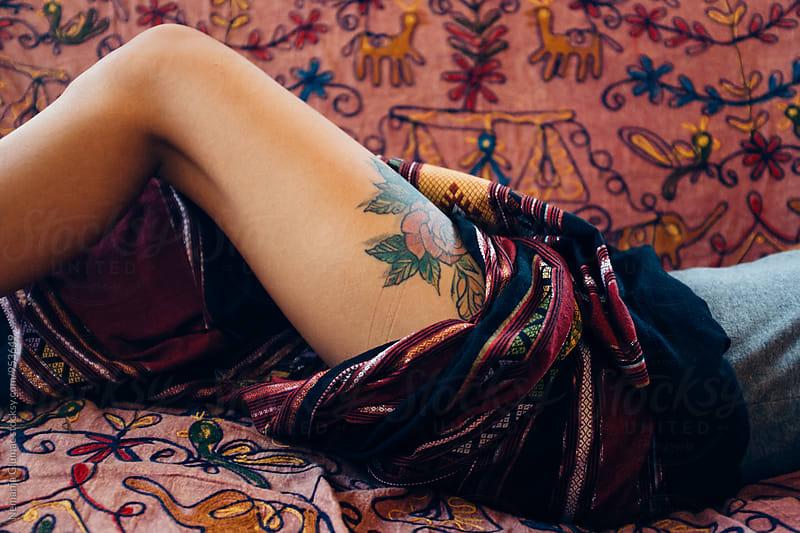 Woman Revealing Her Tattooed Thigh  by Nemanja Glumac for Stocksy United
