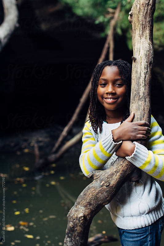 Smiling African American girl on a nature hike by Gabriel (Gabi) Bucataru for Stocksy United