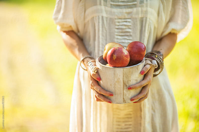 Woman's Hands Holding Nectarines by Lumina for Stocksy United