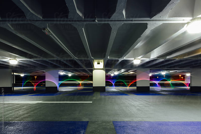 Rainbow light painting in an empty parking lot by Maresa Smith for Stocksy United