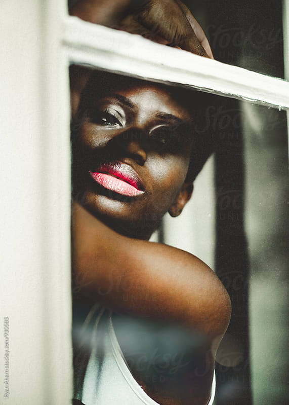 Woman by Window by Ryan Ahern for Stocksy United
